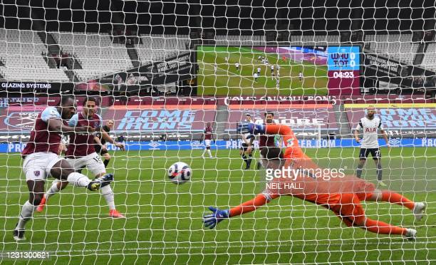 West Ham United's English midfielder Michail Antonio shoots to score the opening goal of the English Premier League football match between West Ham...