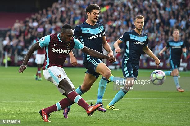 West Ham United's English midfielder Michail Antonio takes a shot that goes high during the English Premier League football match between West Ham...