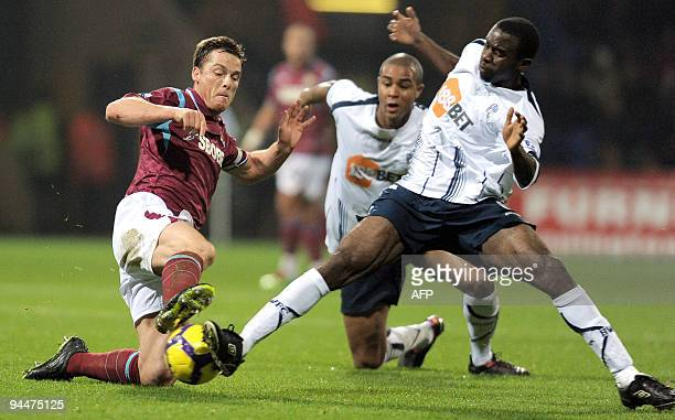 West Ham United's English midfielder Scott Parker vies with Bolton Wanderers' English midfielder Fabrice Muamba during the English Premier League...