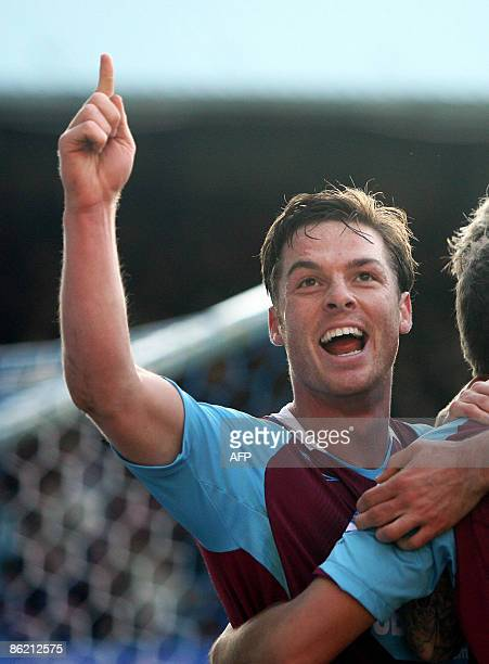 West Ham United's English player Scott Parker celebrates a goal by Craig Bellamy against Portsmouth during their Premier League football match at...