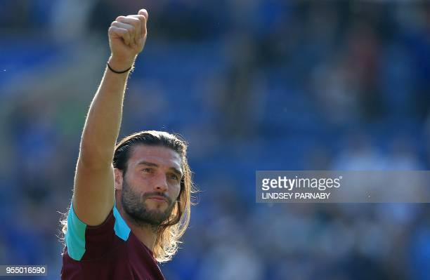 West Ham United's English striker Andy Carroll applauds the fans following the English Premier League football match between Leicester City and West...