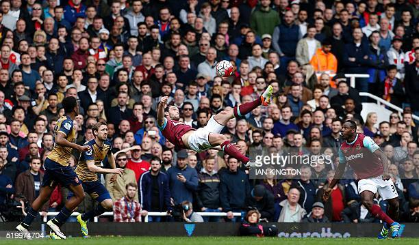 TOPSHOT West Ham United's English striker Andy Carroll attempts an overhead shot on goal during the English Premier League football match between...