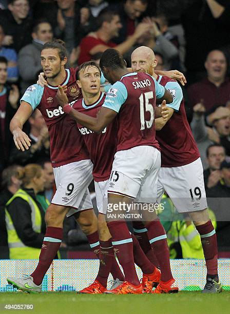 West Ham United's English striker Andy Carroll celebrates after scoring his team's second goal during the English Premier League football match...
