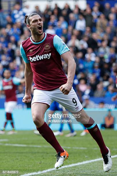 West Ham United's English striker Andy Carroll celebrates scoring an equalising goal for 11 from the penalty spot during the English Premier League...