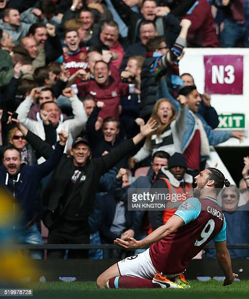 West Ham United's English striker Andy Carroll celebrates scoring his team's second goal during the English Premier League football match between...