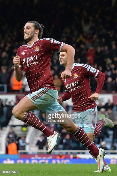 West Ham United's English striker Andy Carroll celebrates scoring West Ham's second goal during the English Premier League football match between...