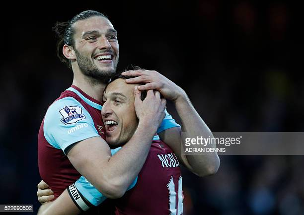 West Ham United's English striker Andy Carroll celebrates with West Ham United's English midfielder Mark Noble after scoring during the English...
