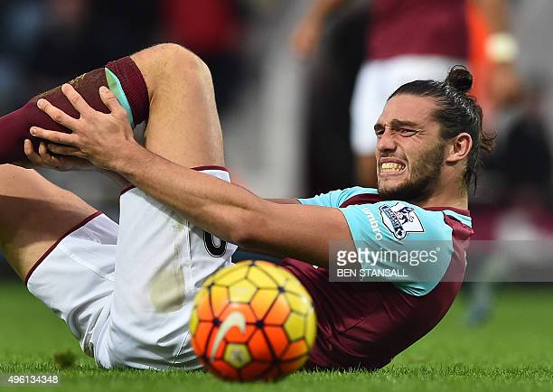West Ham United's English striker Andy Carroll lies injured during the English Premier League football match between West Ham United and Everton at...