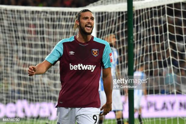 West Ham United's English striker Andy Carroll reacts after missing a goal scoring opportunity during the English Premier League football match...