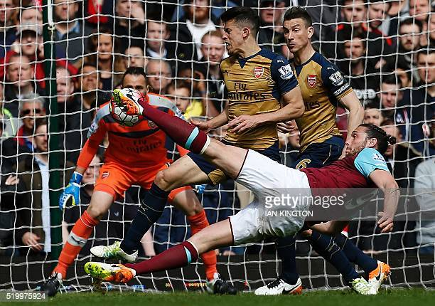 TOPSHOT West Ham United's English striker Andy Carroll shoots to score his team's second goal during the English Premier League football match...