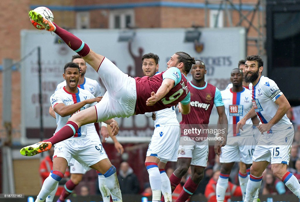 West Ham United's English striker Andy Carroll tries an unsuccessful shot during the English Premier League football match between West Ham United and Crystal Palace at The Boleyn Ground in Upton Park, in east London on April 2, 2016. The game finished 2-2. / AFP / OLLY GREENWOOD / RESTRICTED TO EDITORIAL USE. No use with unauthorized audio, video, data, fixture lists, club/league logos or 'live' services. Online in-match use limited to 75 images, no video emulation. No use in betting, games or single club/league/player publications. /
