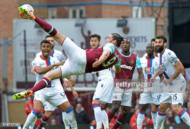West Ham United's English striker Andy Carroll tries an unsuccessful shot during the English Premier League football match between West Ham United...