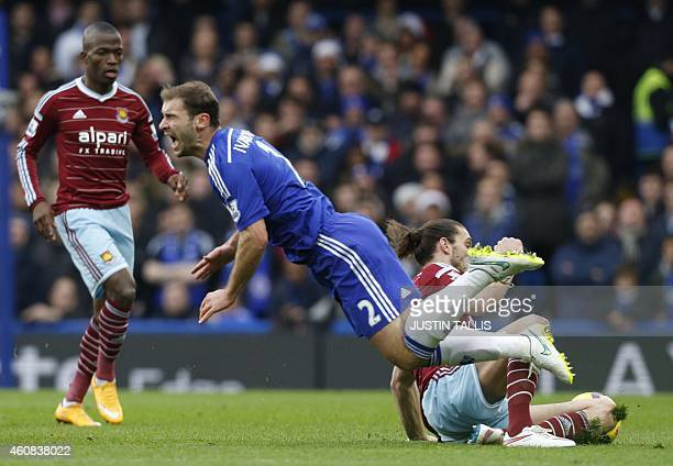West Ham United's English striker Andy Carroll vies with Chelsea's Serbian defender Branislav Ivanovic during the English Premier League football...