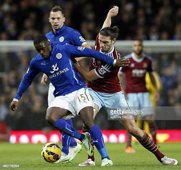 West Ham United's English striker Andy Carroll vies with Leicester City's Ghanaian striker Jeff Schlupp during the English Premier League football...