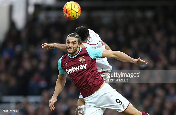 West Ham United's English striker Andy Carroll vies with Liverpool's German midfielder Emre Can during the English Premier League football match...