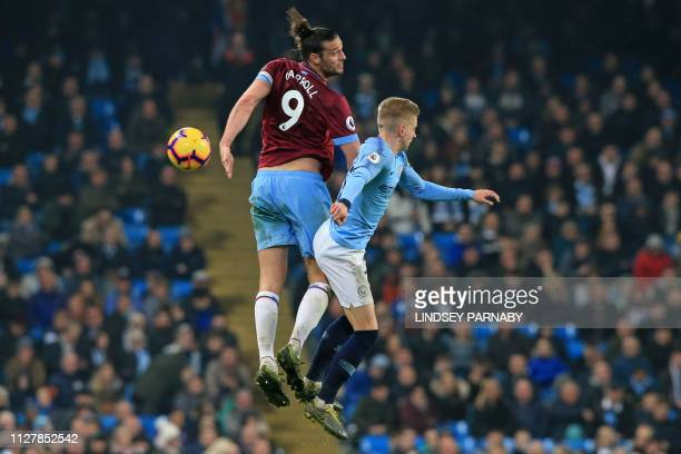 TOPSHOT West Ham United's English striker Andy Carroll vies with Manchester City's Ukrainian midfielder Oleksandr Zinchenko during the English...