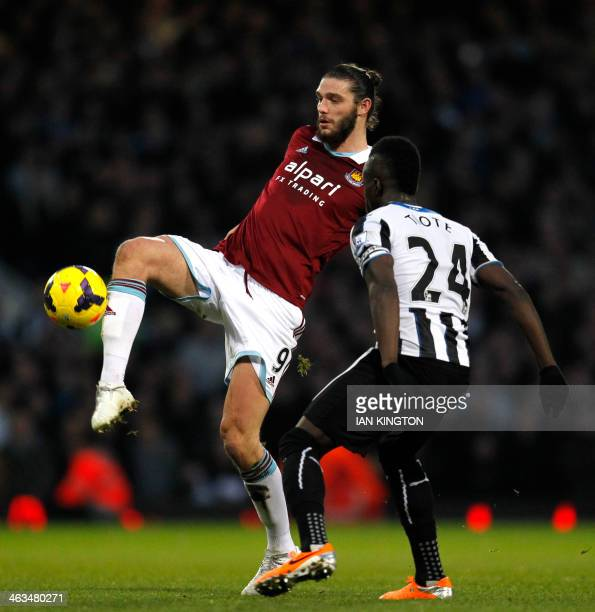 West Ham United's English striker Andy Carroll vies with Newcastle United's Ivorian midfielder Cheick Tiote during the English Premier League...