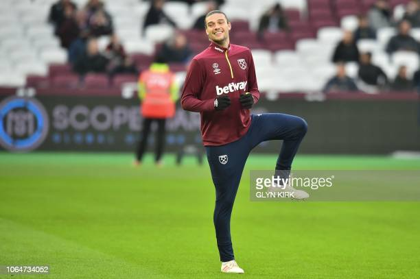 West Ham United's English striker Andy Carroll warms up ahead of the English Premier League football match between West Ham United and Manchester...