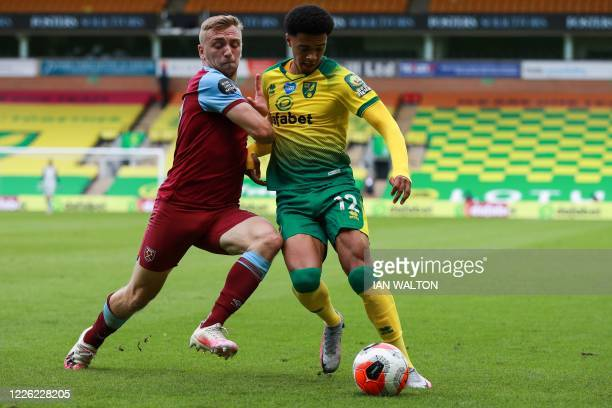 West Ham United's English striker Jarrod Bowen fights for the ball with Norwich City's English-born Northern Irish defender Jamal Lewis during the...