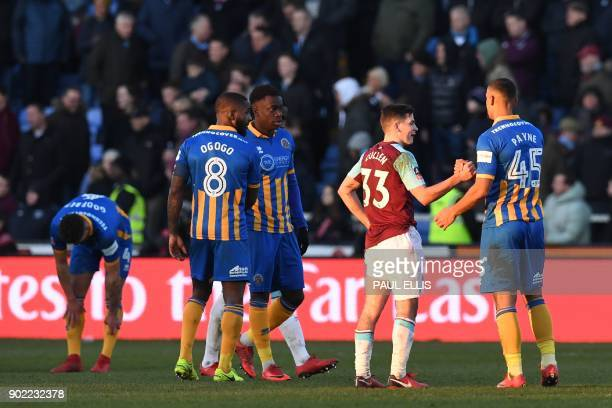 West Ham United's Englishborn Irish midfielder Josh Cullen shakes hands with Shrewsbury Town's English striker Stefan Payne after the English FA Cup...