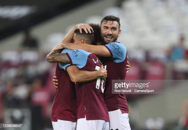 West Ham United's Felipe Anderson celebrates scoring his side's third goal with Robert Snodgrass and Manuel Lanzini during the Carabao Cup Second...