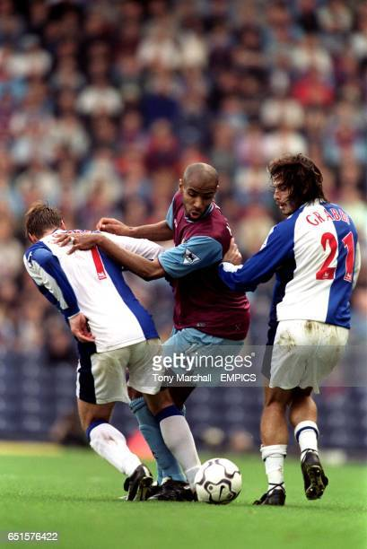 West Ham United's Frederic Kanoute is crowded out by Blackburn Rovers' Garry Flitcroft and Corrado Grabbi