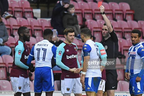 West Ham United's French defender Arthur Masuaku is shown a red card by referee Chris Kavanagh during the English FA Cup fourth round football match...
