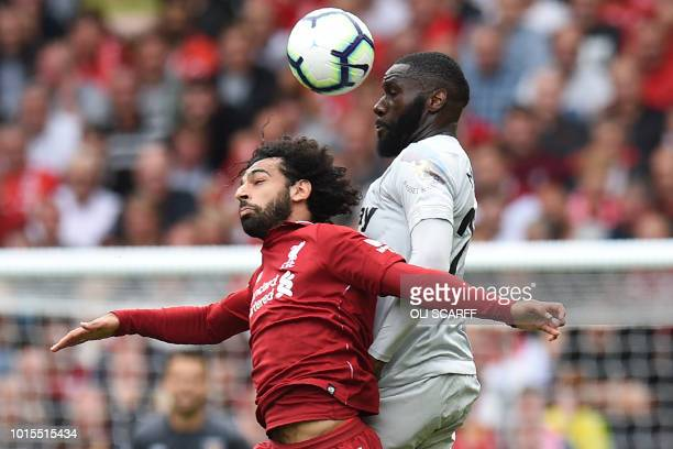 West Ham United's French defender Arthur Masuaku vies with Liverpool's Egyptian midfielder Mohamed Salah during the English Premier League football...