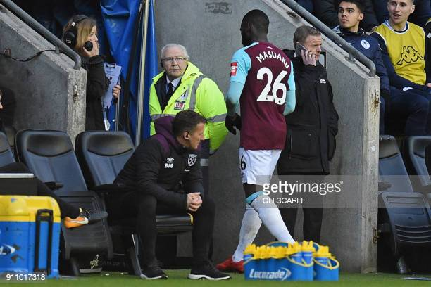 West Ham United's French defender Arthur Masuaku walks down the tunnel after being shown is shown a red card by referee Chris Kavanagh during the...