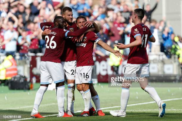 West Ham United's French defender Arthur Masuaku West Ham United's Ukrainian striker Andriy Yarmolenko West Ham United's English midfielder Mark...