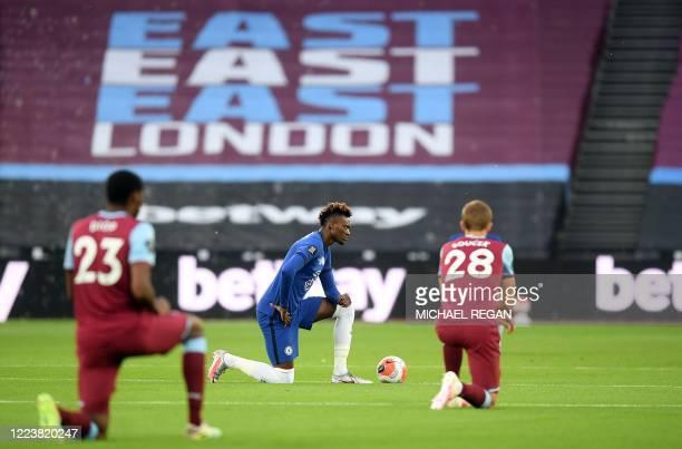 West Ham United's French defender Issa Diop , Chelsea's English striker Tammy Abraham and West Ham United's Czech midfielder Tomas Soucek kneel in...