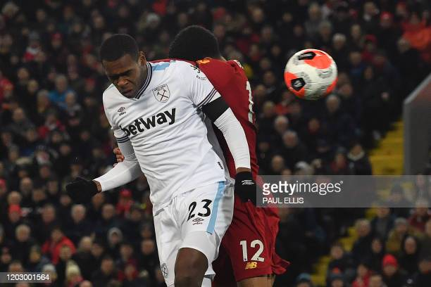 West Ham United's French defender Issa Diop scores the equalising goal during the English Premier League football match between Liverpool and West...