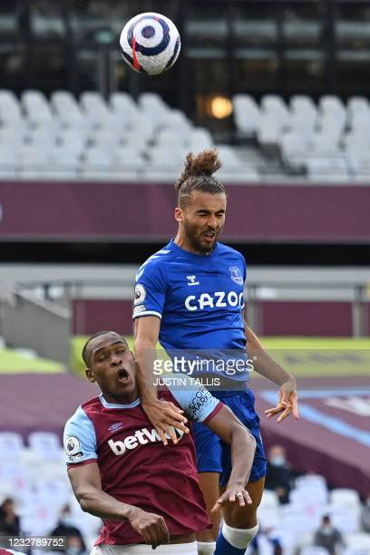 West Ham United's French defender Issa Diop vies with Everton's English striker Dominic Calvert-Lewin during the English Premier League football...