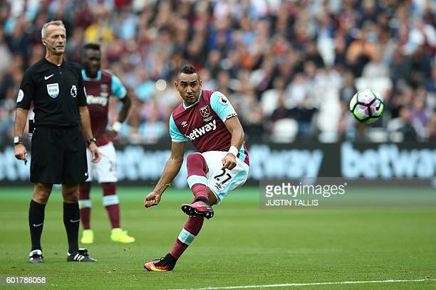 West Ham United's French midfielder Dimitri Payet takes a free kick during the English Premier League football match between West Ham United and...