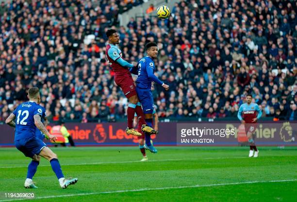 West Ham United's French striker Sebastien Haller jumps above Everton's English defender Mason Holgate to header the ball wide of the goal during the...