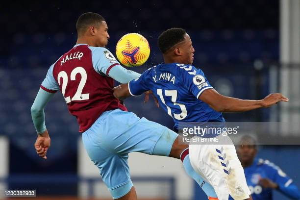 West Ham United's French striker Sebastien Haller vies with Everton's Colombian defender Yerry Mina during the English Premier League football match...