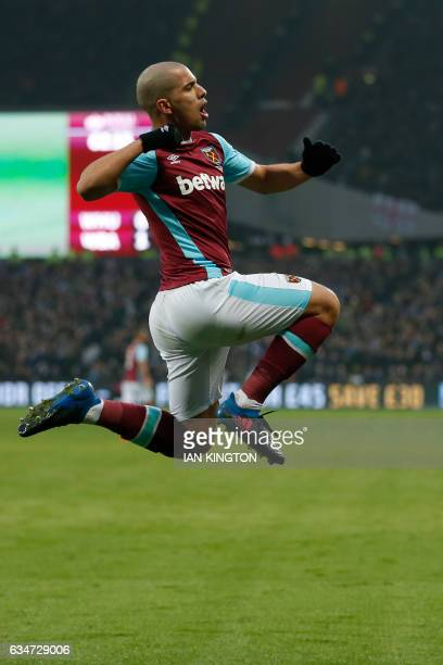 West Ham United's Frenchborn Algerian midfielder Sofiane Feghouli celebrates after scoring their first goal during the English Premier League...
