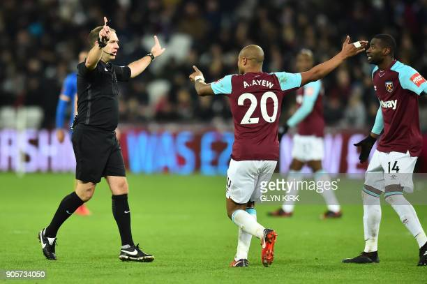 West Ham United's Frenchborn Ghanaian midfielder Andre Ayew and West Ham United's Spanish midfielder Pedro Obiang appeal to referee Jeremy Simpson...