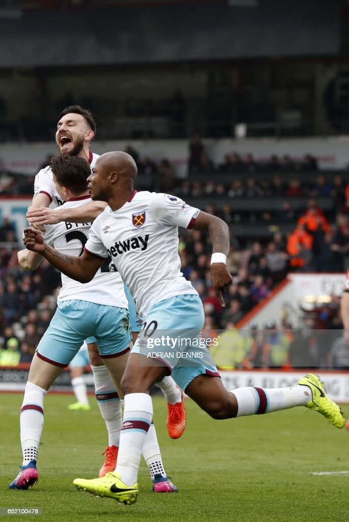 West Ham United's French-born Ghanaian midfielder Andre Ayew (R) celebrates after scoring their second goal during the English Premier League football match between Bournemouth and West Ham United at the Vitality Stadium in Bournemouth, southern England on March 11, 2017. / AFP PHOTO / Adrian DENNIS / RESTRICTED TO EDITORIAL USE. No use with unauthorized audio, video, data, fixture lists, club/league logos or 'live' services. Online in-match use limited to 75 images, no video emulation. No use in betting, games or single club/league/player publications. /