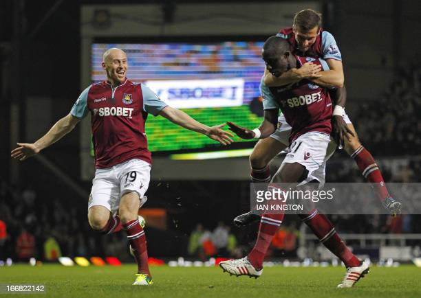 West Ham United's Frenchborn Senegalese midfielder Mohamed Diame celebrates scoring their second goal with Welsh defender James Collins and English...