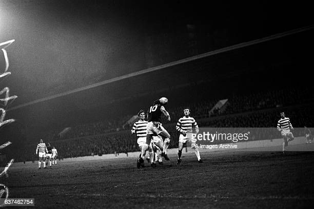 West Ham United's Geoff Hurst heads his team's first goal as Celtic's David Hay and Billy McNeill look on