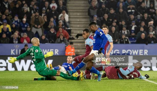 West Ham United's goalkeeper Darren Randolph saves at the feet of Leicester City's Kelechi Iheanacho during the Premier League match between...