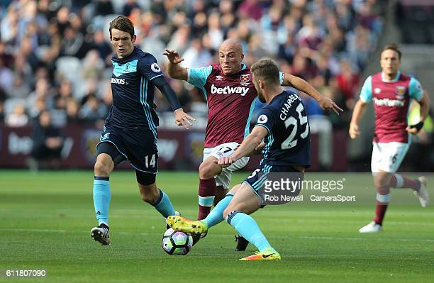 West Ham United's Gokhan Tore is tackled by Middlesbrough's Calum Chambers during the Premier League match between West Ham United and Middlesbrough...