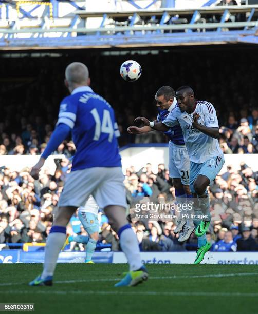 West Ham United's Guy Demel and Everton's Leon Osman battle for the ball