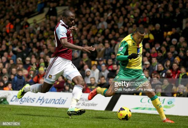 West Ham United's Guy Demel and Norwich City's Martin Olsson battle for the ball
