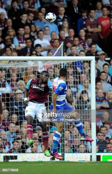 West Ham United's Guy Demel and Reading's Nick Blackman jump for a high ball during the Barclays Premier League match at Upton Park London
