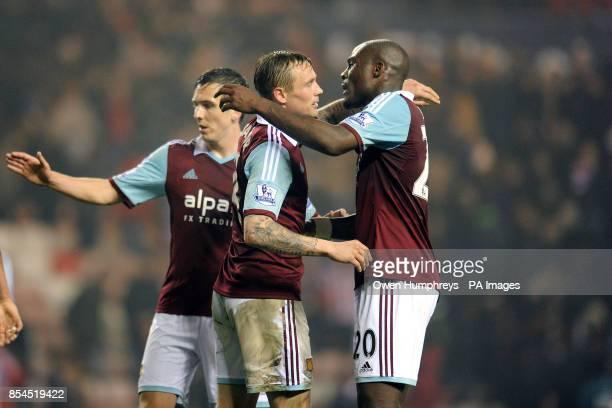 West Ham United's Guy Demel celebrates with Matthew Taylor