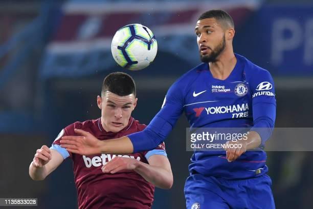 West Ham United's Irish defender Declan Rice vies with Chelsea's English midfielder Ruben LoftusCheek during the English Premier League football...