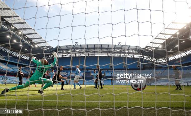 West Ham United's Irish goalkeeper Darren Randolph concedes a goal from Manchester City's English defender John Stones during the English Premier...