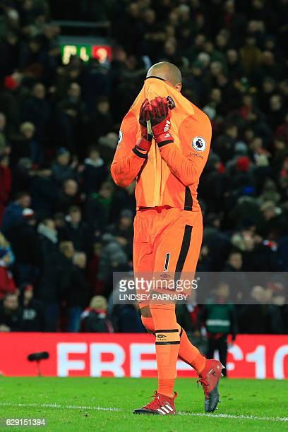 West Ham United's Irish goalkeeper Darren Randolph reacts at the final whistle during the English Premier League football match between Liverpool and...